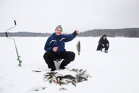 Happy ice fisher with catch.